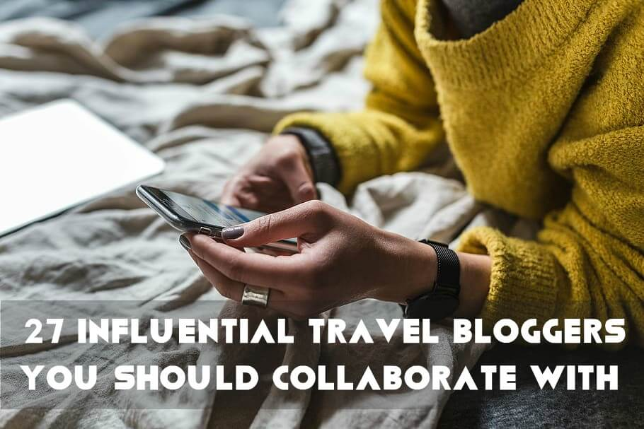 Travel Influencer texting on his blog to collaborate with brands